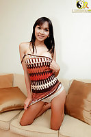 Shy Asian shemale stripping