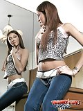 Long Haired Tranny In Jeans Posing & Undressing