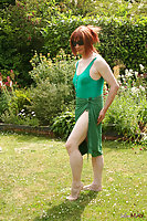 Redhaired Tranny In Swimsuit Bronzing