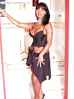 Tanned Exotic Tranny Undresses & Poses