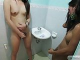 Naked ladyboys jerk in a toilet