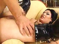 Ladyboy in latex boots gets anal bonking