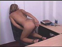 Office shemale pleases herself on a table