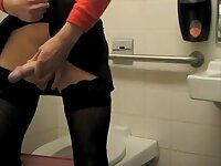 Sissy slut strokes in a public bathroom