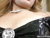 Latina shemale blonde Josiane is masturbating and toying
