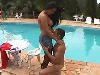 Crazy busty tranny drills a guy by a pool