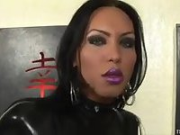 Tranny in latex jerking off