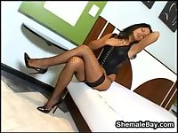Dark Shemale In Stockings And Heels