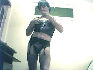 Solo Crossdresser Clothing Himself On Cam