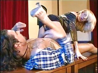 Blonde Shemale has fun with her friend on the table
