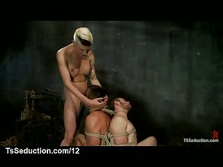 Two bound guys throat fucked by a busty tranny