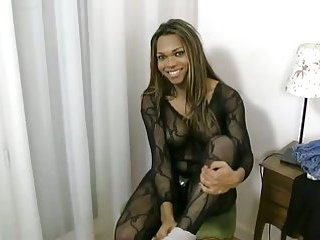 Slutty black tranny shows her dick