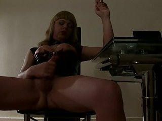 Tgirl in latex smokes before masturbation