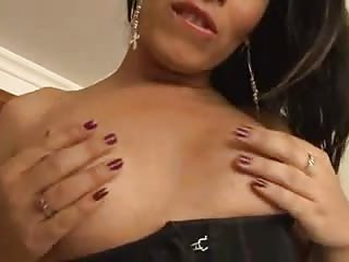 Solo brunette with small tits masturbates on the bed
